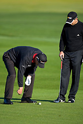 February 14, 2010; Pebble Beach, CA, USA;  John Senden seeks advice from Sergio Garcia on the second hole regarding his ball that hit a plug in the fairway during the final round of the AT&T Pebble Beach Pro-Am at Pebble Beach Golf Links.