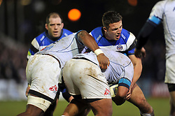 Sam Burgess of Bath Rugby puts in a big tackle - Photo mandatory by-line: Patrick Khachfe/JMP - Mobile: 07966 386802 12/12/2014 - SPORT - RUGBY UNION - Bath - The Recreation Ground - Bath Rugby v Montpellier - European Rugby Champions Cup