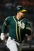 Oakland Athletics shortstop Franklin Barreto (1) runs to first base on a hit against the San Francisco Giants at AT&T Park in San Francisco, California, on March 26, 2018. (Stan Olszewski/Special to S.F. Examiner)