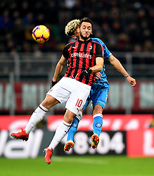 MILAN, Jan. 27, 2019  AC Milan's Hakan Calhanoglu (L) vies with Napoli's Kevin Malcuit during a Serie A soccer match between AC Milan and Napoli in Milan, Italy, Jan. 26 , 2019. The match ended 0-0. (Credit Image: © Daniele Mascolo/Xinhua via ZUMA Wire)