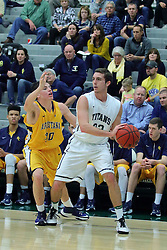 21 February 2017:  Austin Amann defended by Dylan Sortillo during an College men's division 3 CCIW basketball game between the Augustana Vikings and the Illinois Wesleyan Titans in Shirk Center, Bloomington IL
