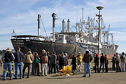 Crowds gather to watch as dock hands work during the arrival of the Solon Turman, to the newly re-opened dry docks located on Mare Island in Vallejo, Calif.  California Dry Dock Solutions was recently awarded a $3.1 Million contract from the U.S.Navy to dismantle two ships  currently located in Suisun Bay.