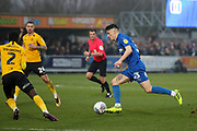 AFC Wimbledon midfielder Callum Reilly (33) dribbling and about to score goal during the EFL Sky Bet League 1 match between AFC Wimbledon and Southend United at the Cherry Red Records Stadium, Kingston, England on 1 January 2020.