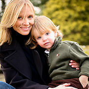 A mother poses with her toddler boy during a professional family portrait shot by Alexandra Tremaine.