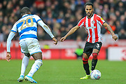 Brentford defender Rico Henry (3), Queens Park Rangers midfielder Bright Osayi-Samuel (20), during the EFL Sky Bet Championship match between Brentford and Queens Park Rangers at Griffin Park, London, England on 11 January 2020.