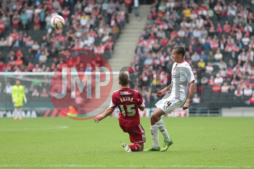 Milton Keynes Dons' Dele Alli is challenged by Bristol City's Joe Bryan  <br />   - Photo mandatory by-line: Nigel Pitts-Drake/JMP - Tel: Mobile: 07966 386802 24/08/2013 - SPORT - FOOTBALL - Stadium MK - Milton Keynes - Milton Keynes Dons V Bristol City - Sky Bet League One