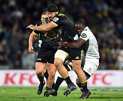 Hurricanes Ben May tackled by Sharks Lubabalo Mtembu in the Super Rugby match at McLean Park, Napier, New Zealand, Friday, April 06, 2018. Credit:SNPA / Ross Setford