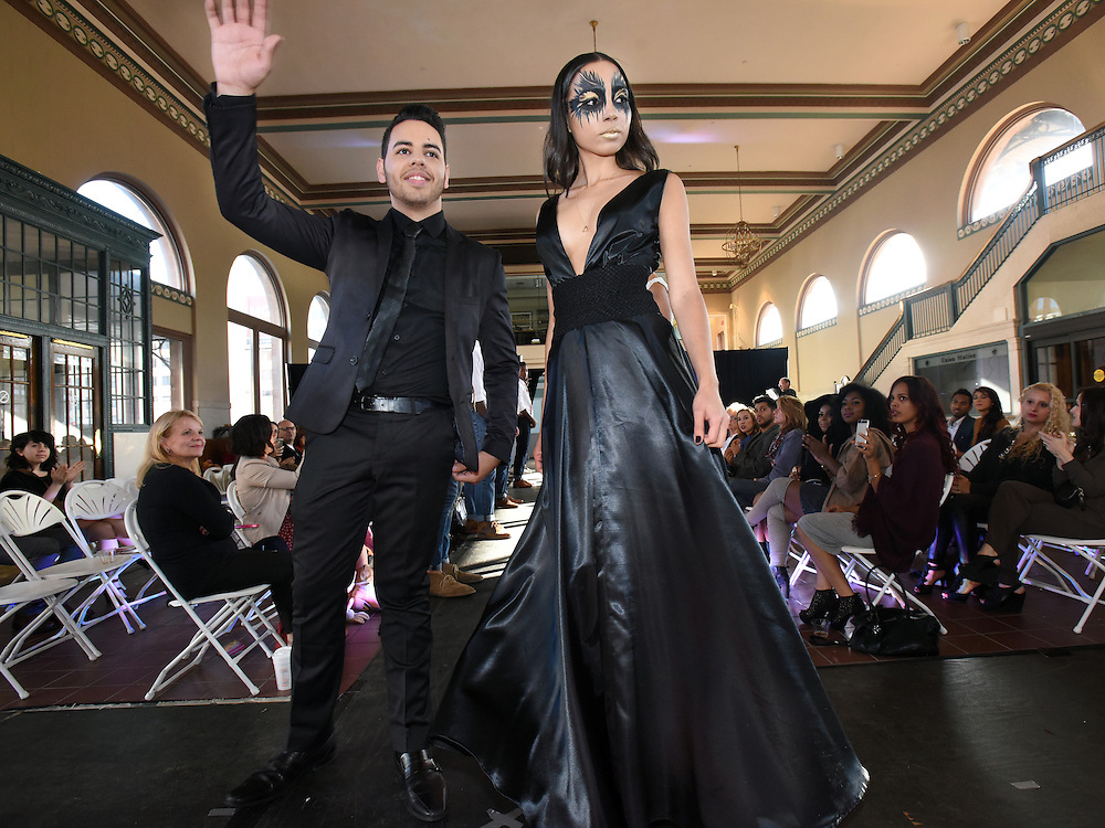 Photo by Mara Lavitt -- Special to the Hartford Courant<br /> October 4, 2015 <br /> Hartford Fashion Week, last day, Union Station, Hartford. Six designers showed their fashions. AER Collections designers Adrean Enrique, left, and Christina Alexandra, right, both of Hartford at the end of their show.
