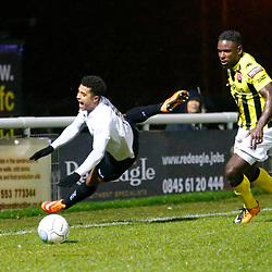 Dover's forward Jamie Allen is sent crashing to the ground by AFC Fylde's defender Zaine Francis-Angol during the National League match between Dover Athletic FC and AFC Flyde at Crabble Stadium, Kent on 08 December 2018. Photo by Matt Bristow.