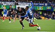Kyle Bennett goes down under Lee Collins challenge during the Sky Bet League 2 match between Portsmouth and Mansfield Town at Fratton Park, Portsmouth, England on 24 October 2015. Photo by Michael Hulf.