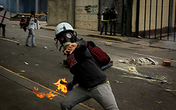 A demonstrator throws Molotov bomb against the Bolivarian National Guard in Altamira this May 3, 2017 in another day of protest against President Nicolas Maduro.