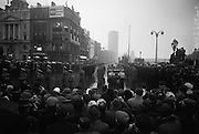 The remains of Roger Casement, Irish Patriot, were removed from the Military Church, Arbour Hill, where they lay in state for 4 days, to the Pro-Cathedral. Onlookers watch as the funeral procession passes the O'Connell monument..18.02.1965
