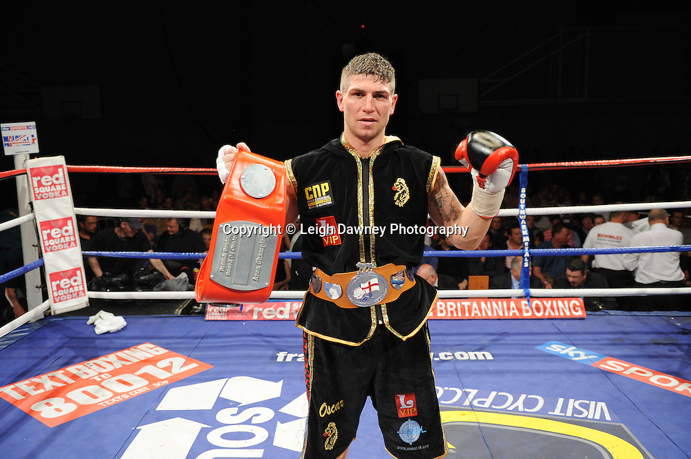 Brian Rose (pictured with belts) defeats Martin Welsh for the English Light Middleweight title at Medway Park, Gillingham, Kent, UK on 13th May 2011. Frank Maloney Promotions. Photo credit © Leigh Dawney 2011.