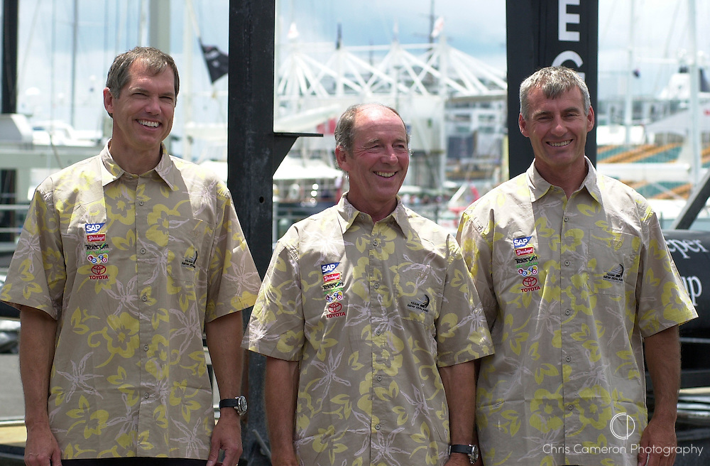 Team New Zealand designers Clay Oliver, Tom Schnackenburg and Mike Drummond pose beside the appendages of NZL 81 and NZL 82 on unveiling day. 7/1/2003 (© Chris Cameron 2002)