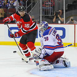 Sep 16, 2013; Newark, NJ, USA; New York Rangers goalie Henrik Lundqvist (30) makes a save on New Jersey Devils center Jacob Josefson (16) during the second period at Prudential Center.