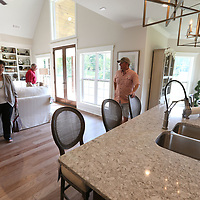 Martha Waycster, from left, and her husband, Benny, get a look at the St. Jude Dream Home with builder, Mark Simpson, after they were announced the winners.