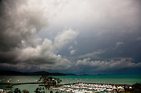 A storm rolls across the skies above the marina in Airlie Beach, Australia.