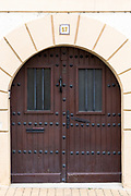 New doorway in traditional old arched style with iron studs and grilles at Ororbia (Olza) in Basque region of Northern Spain