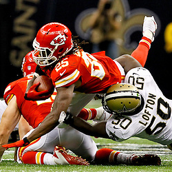September 23, 2012; New Orleans, LA, USA; Kansas City Chiefs running back Jamaal Charles (25) dives forward for a first down past New Orleans Saints linebacker Curtis Lofton (50) during overtime of a game at the Mercedes-Benz Superdome. The Chiefs defeated the Saints 27-24 in overtime. Mandatory Credit: Derick E. Hingle-US PRESSWIRE