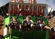 Patrons of the Maryland State Fair react to being dropped 120 feet from the top of the Super Shot carnival ride on Saturday, September 4, 2010 in Timonium, MD.