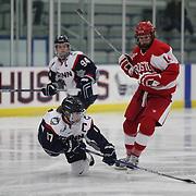 Leah Lum, UConn, is challenged by Maddie Elia, Boston University during the UConn Vs Boston University, Women's Ice Hockey game at Mark Edward Freitas Ice Forum, Storrs, Connecticut, USA. 5th December 2015. Photo Tim Clayton