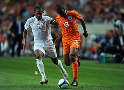 Ryan Babel of Holland and Glen Johnson England during the International Friendly between Netherlands and England at the Amsterdam Arena on August 12, 2009 in Amsterdam, Netherlands.