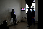 Immigrants watching Tv it the center of identifications and expulsion(CIE) waiting to be released.<br /> 27 january 2014 . Daniele Stefanini /  OneShot