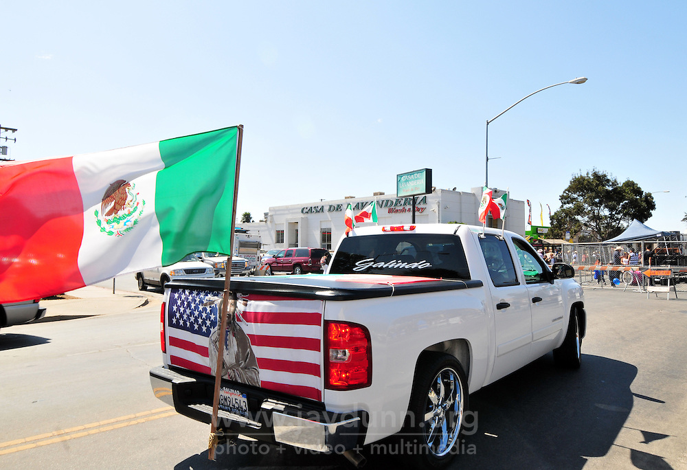 "Flags were everywhere for Sunday's ""El Grito"" celebration in Salinas marking the anniversary on September 16th of Mexico's independence from Spain. The annual fiesta, which occupies East Alisal Street between Wood and Sanborn, brimmed as usual with booths selling patriotic souvenirs and all manner of food and drink. Local businesses and nonprofits manned booths with information about health and community programs, while traditional ""bandas"" filled the afternoon with dance music and good cheer."