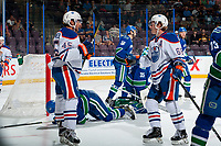 PENTICTON, CANADA - SEPTEMBER 11: Chad Butcher #65 and Joseph Gambardella #45 of Edmonton Oilers put the puck past Thatcher Demko #35 of Vancouver Canucks during second period on September 11, 2017 at the South Okanagan Event Centre in Penticton, British Columbia, Canada.  (Photo by Marissa Baecker/Shoot the Breeze)  *** Local Caption ***