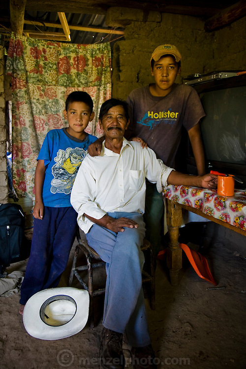 The father of rancher José Angel Galaviz Carrillo, with Jose's sons at their home in the Sierra Mountains near Maycoba, in the Mexican state of Sonora.  (José Angel Galaviz Carrillo is featured in the book What I Eat: Around the World in 80 Diets.)