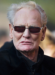© London News Pictures. 05/11/2014. Cream drummer GINGER BAKER arriving for the service. The funeral Jack Bruce at Golders Green Crematorium in North London. Jack Bruce was the lead singer and bass player for British Rock band Creme, alongside Eric Clapton and Ginger Baker. Creme sold over 15 million albums worldwide and were widely considered to be the worlds first successful supergroup. Photo credit : Ben Cawthra/LNP