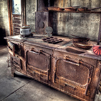 A rusty cooking stove found in the gold mine kitchen, USA