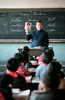 April 1985, Beijing, China --- A teacher quizzes schoolchildren on basic English words in Beijing, China. --- Image by © Owen Franken/CORBIS