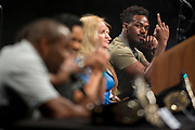 DALLAS, TX - MAY 12:  Jon Jones speaks to Daniel Cormier during the UFC Summer Kickoff Press Conference at the American Airlines Center on May 12, 2017 in Dallas, Texas. (Photo by Cooper Neill/Zuffa LLC/Zuffa LLC via Getty Images) *** Local Caption *** Jon Jones