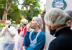 Volunteers take a breather after  portioning out dry food into sachets as they prepare food parcels at a, to be distributed to Vanwyk'svlei in Wellington, Western Cape, South Africa.(Picture: JULIAN GOLDSWAIN)