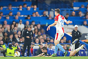Chelsea midfielder Mateo Kovacic (17) is fouled by Slavia Prague defender Ondrej Kudela (15) during the Europa League  quarter-final, leg 2 of 2 match between Chelsea and Slavia Prague at Stamford Bridge, London, England on 18 April 2019.