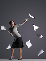 Young Businesswoman with Scattering Papers side view