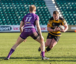 Newports' Evan Whitson charges towards the line with Ebbw Vales' Toby Fricker ready to make he tackle.<br /> <br /> Photographer Simon Latham/Replay Images<br /> <br /> Principality Premiership - Newport v Ebbw Vale - Sunday 4th February 2018 - Rodney Parade - Newport<br /> <br /> World Copyright © Replay Images . All rights reserved. info@replayimages.co.uk - http://replayimages.co.uk