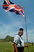 """Geordie' George and the Dundee Diehards are already in place and have hoisted the Red Coat's British Flag. .South Africa. Kwa Zulu Natal. Isandlwana battlefield. .©Zute Lightfoot.DVD0018"