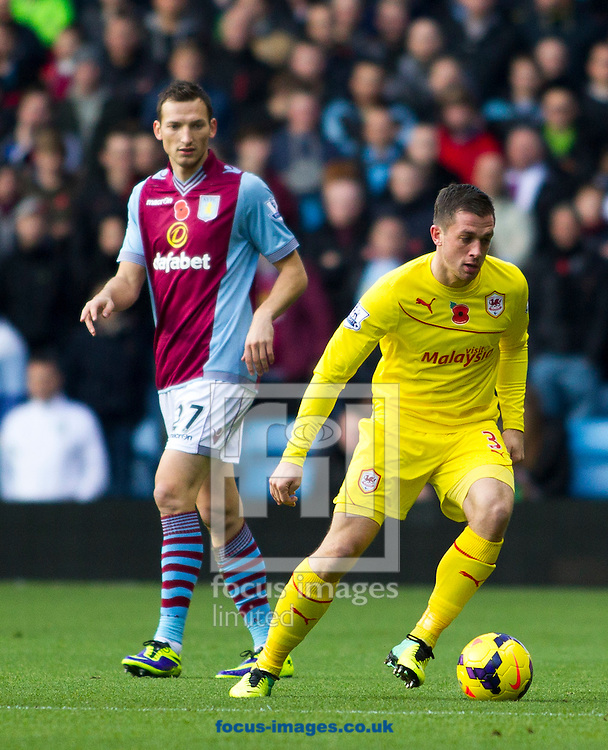 Picture by Mike  Griffiths/Focus Images Ltd +44 7766 223933<br /> 09/11/2013<br /> Libor Kozak of Aston Villa and Andrew Taylor of Cardiff City during the Barclays Premier League match at Villa Park, Birmingham.