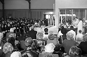 Funeral Of Eamon Andrews.   (R67)..1987..10.11.1987..11.10.1987..10th November 1987..Today saw the funeral of the broadcaster,Eamon Andrews. The funeral mass was held in St Anne's Church, Portmarnock, Co Dublin with the removal to Balgriffin Cemetery, Co Dublin...Image shows a section of the congregation at the funeral mass of broadcaster Eamon Andrews as prayers are said over the coffin.