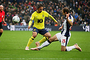 West Bromwich Albion defender Craig Dawson (25) tackles Blackburn Rovers midfielder Bradley Dack (23)  during the EFL Sky Bet Championship match between West Bromwich Albion and Blackburn Rovers at The Hawthorns, West Bromwich, England on 27 October 2018.