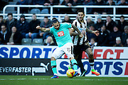 Derby County midfielder Bradley Johnson (#15) and Newcastle United forward Aleksandar Mitrovic (#45) battle for the ball during the EFL Sky Bet Championship match between Newcastle United and Derby County at St. James's Park, Newcastle, England on 4 February 2017. Photo by Craig Doyle.
