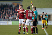 Northampton Town Striker James Collins is shown a yellow card  during the Sky Bet League 2 match between Northampton Town and Cambridge United at Sixfields Stadium, Northampton, England on 12 March 2016. Photo by Dennis Goodwin.