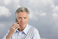 Man using phone in front of clous