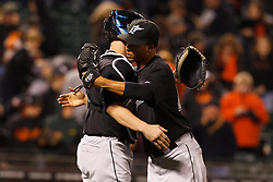 May 24, 2011; San Francisco, CA, USA;  Florida Marlins relief pitcher Leo Nunez (right) celebrates with catcher John Buck (left) after the game against the San Francisco Giants at AT&T Park. Florida defeated San Francisco 5-1.