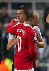 NEWCASTLE, ENGLAND - Tuesday, April 19, 2011: Manchester United's Wayne Rooney and Newcastle United's Joey Barton embrace at the final whistle during the Premiership match at St James' Park. (Photo by David Rawcliffe/Propaganda)