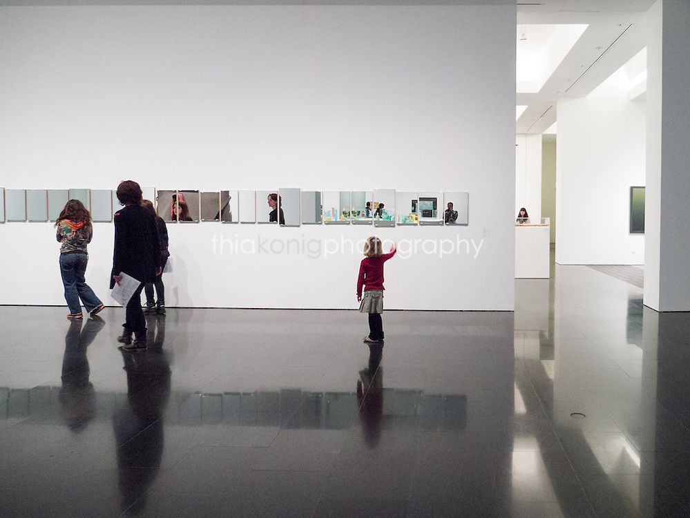 Child points to art exhibit at the Barcelona Museum of Contempory Art.