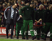 Photo: Paul Thomas.<br /> Liverpool v Arsenal. Carling Cup. 09/01/2007.<br /> <br /> Mark Gonzalez gets carried off watched by Liverpool manager Rafael Benitez.