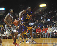 "Ole Miss guard Will Norman (24)  throws the ball back inbounds in front of Ole Miss forward Steadman Short (15) at the C.M. ""Tad"" Smith Coliseum in Oxford, Miss. on Wednesday, February 9, 2011. Ole Miss won 66-60 and is now 4-5 in the Southeastern Conference."